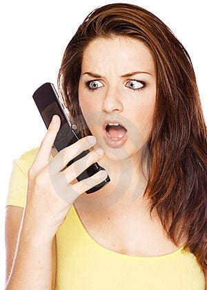 woman-looking-shocked-at-her-phone-thumb11063485